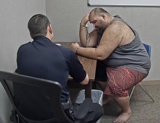 Redding resident Benjamin Pouvi Fata, 36, is interviewed by Redding police on Jan. 15, 2021.