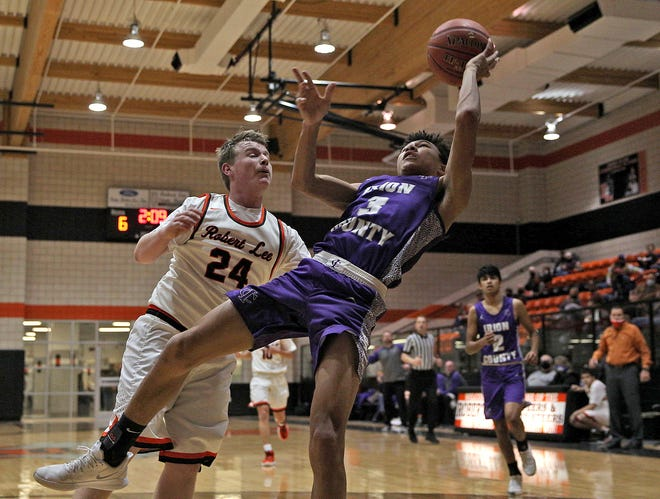 Irion County's Jordan Harrison (3) attempts to tap the ball back during a rebound attempt against Robert Lee's Mason Fowler (24) during a high school boys basketball game in Robert Lee Friday, Jan. 15, 2021.
