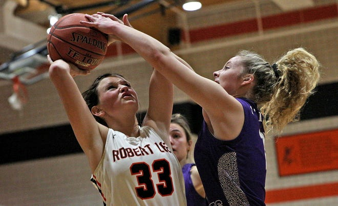 FILE PHOTO: Kailey Freeman, left, tries to put up a shot for Robert Lee while Irion County's Melanie Rainey defends during a high school girls basketball game in Robert Lee Friday, Jan. 15, 2021.
