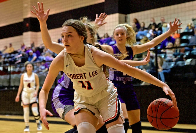 Braylee Hood drives toward the basket for Robert Lee during a game against Irion County on Friday, Jan. 15, 2021.