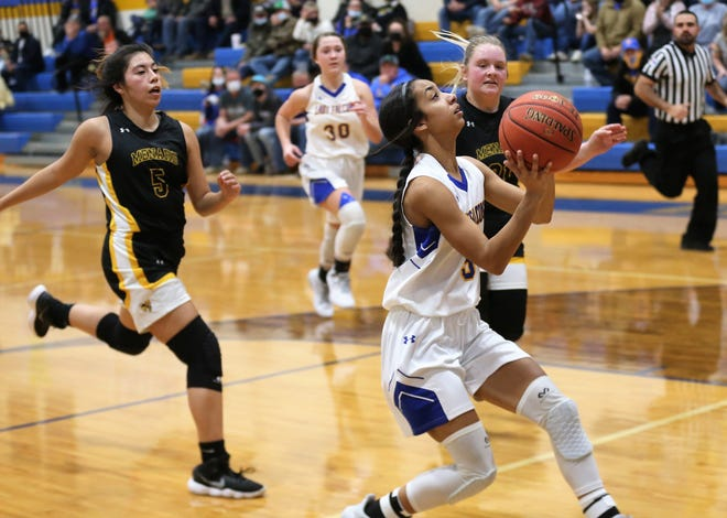 Veribest's Alliyah Harrison goes up for a layup while Menard's Menard's Jalyn Montes (5) and Mackenzie Wagner (21) defend during a home game against Menard on Friday, Jan. 15, 2021.