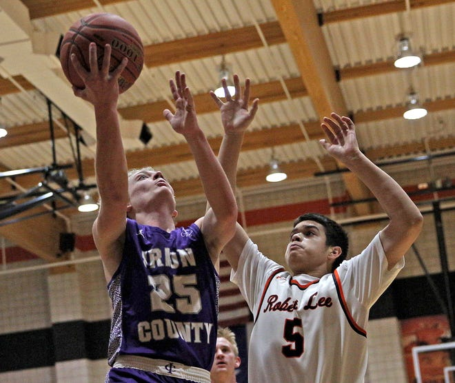 Irion County's Parker Conner (25) goes up for a shot against Robert Lee's Braiden Murphy (5) during a high school boys basketball game in Robert Lee Friday, Jan. 15, 2021.