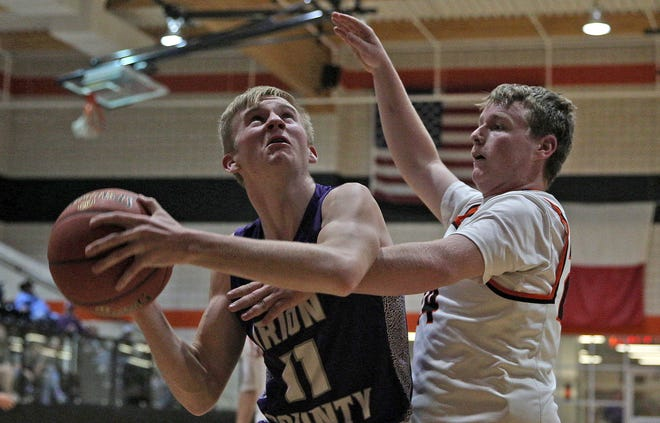 Irion County's Trevin Coffell (11) goes up for a shot while Robert Lee's Mason Fowler defends during a high school boys basketball game in Robert Lee Friday, Jan. 15, 2021.