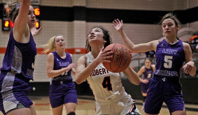 Jullisa Ureno, center, drives toward the basket for Robert Lee during a game against Irion County on Friday, Jan. 15, 2021.