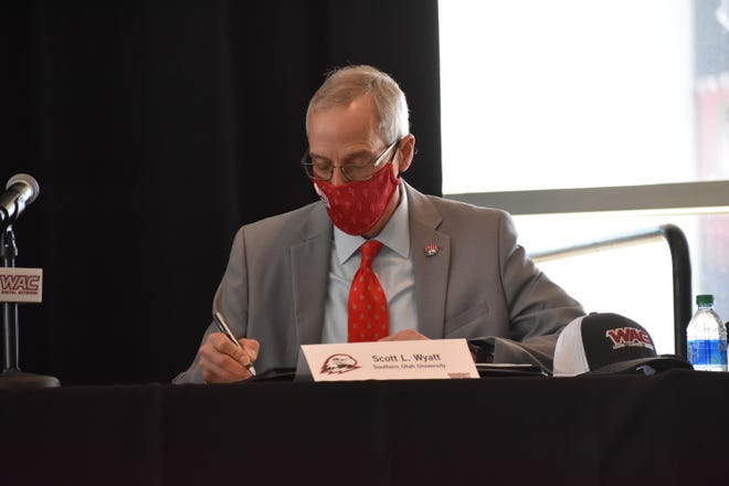 SUU president Scott Wyatt ceremoniously signs with the Western Athletic Conference on Thursday, January 14, 2021.