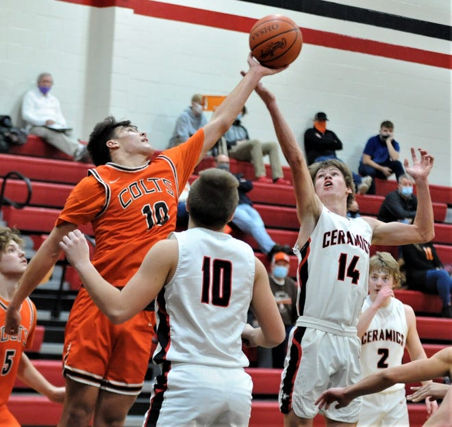 Meadowbrook's Davis Singleton and Crooksville's Blake White battle for a rebound in Friday's game. The Colts won 81-53.