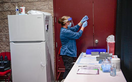 Revonda Wood, RN, pulls a dose from a Pfizer-BioNTech COVID-19 vial at the AnMed Health Covid-19 Vaccine clinic at the Anderson Civic Center Saturday, January 16, 2021.
