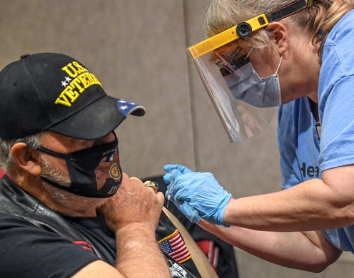 Jack Horneman of Townville gets his COVID-19 vaccine from Missy Cooley, LPN, during the AnMed Health Covid-19 Vaccine clinic at the Anderson Civic Center Saturday, January 16, 2021.
