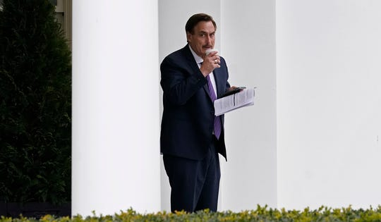 Michael Lindell, CEO of My Pillow, Inc., waits to go into the West Wing of the White House, Friday, Jan. 15, 2021, in Washington.