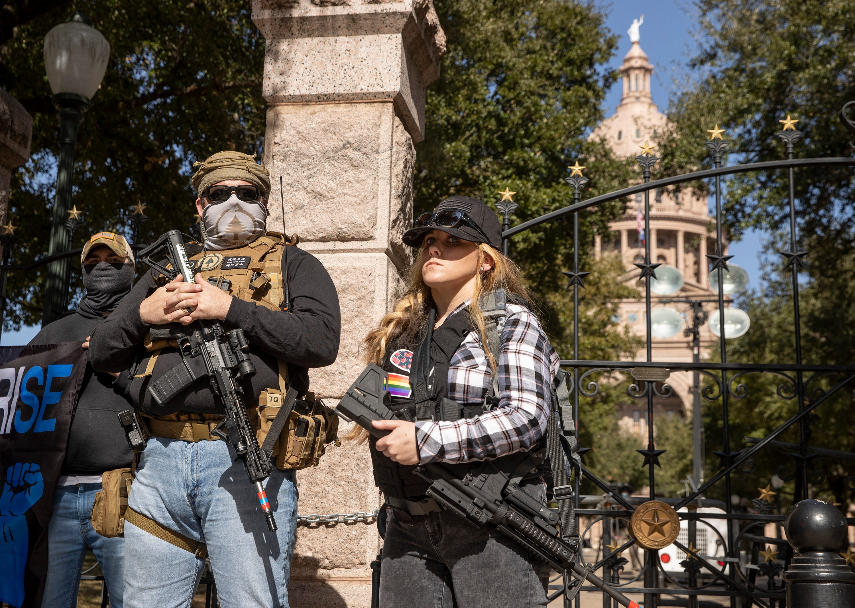 Jeinay LeBlanc, right, carries a gun while rallying for gun rights at the Capitol in Austin, Texas, on Sunday, Jan. 17, 2021.