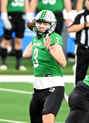 Southlake Carroll quarterback Quinn Ewers throws a pass during the Dragons' 52-34 loss to Westlake in the Class 6A Division I state championship game in January. Ewers announced Monday that he'll forgo his senior year to enroll early at Ohio State.