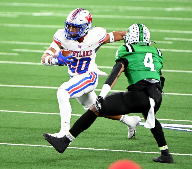 Westlake's Zane Minors dashes past Southlake Carroll's Cinque Williams in the first half of the Chaparrals' 52-34 victory in the Class 6A Division I state championship game Saturday night. Minors scored on a 75-yard run on Westlake's first offensive play.