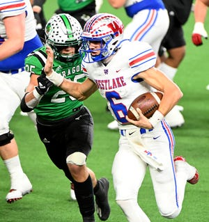 Westlake's Cade Klubnik runs past Southlake Carroll's Barrett Baker during the Chaparrals' state championship win Saturday night. Klubnik was named the offensive MVP.