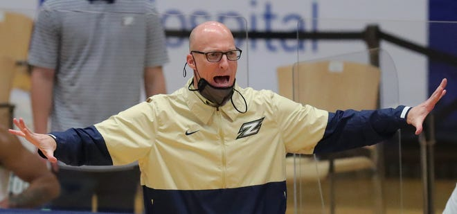 University of Akron coach John Groce reacts to a play during the first half of an NCAA basketball game, Saturday, Jan. 16, 2021, in Akron, Ohio. [Jeff Lange/Beacon Journal]