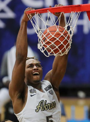 University of Akron forward Camron Reece (5) came off the bench to provide the Zips with the spark they needed in Friday night's 88-79 win over Ball State. Reece scored 16 points. [Jeff Lange/Beacon Journal]