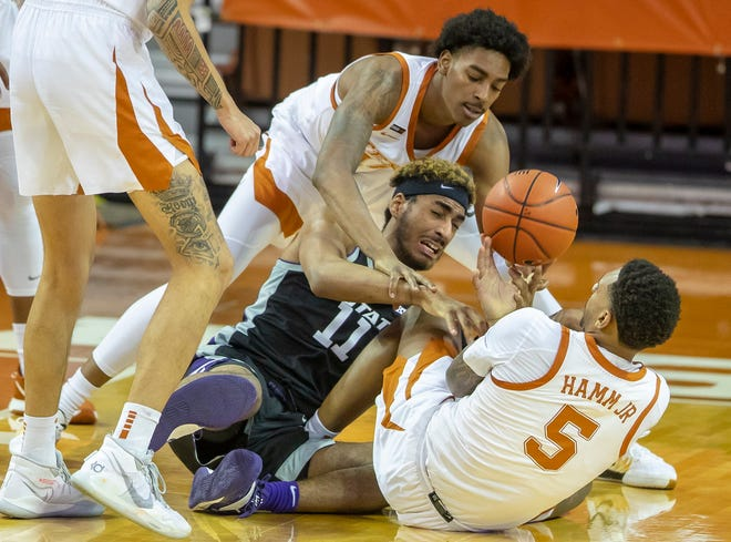 Kansas State's Antonio Gordon battles for a loose ball with Texas' Donovan Williams and Royce Hamm Jr. in the first half of the Longhorns' victory Saturday night at the Erwin Center.