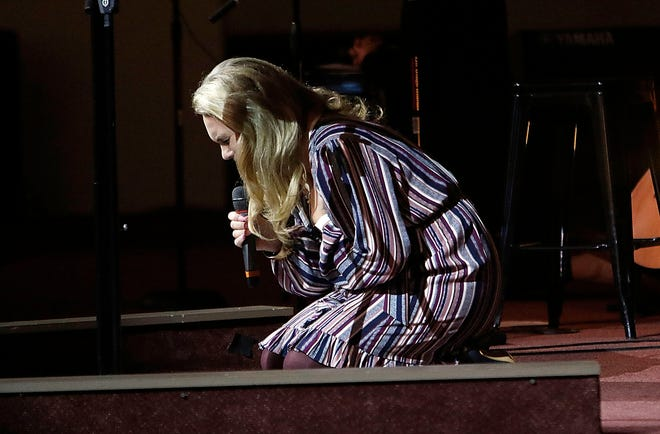 Ashland Pregnancy Care Center Executive Director Melanie Miller prays on her knees for the prayer focus No. 3, for repentance and awakening and the Sin on Abortion at the Sanctity of Human Life Community Prayer Service Sunday at Grace Church. TOM E. PUSKAR/TIMES-GAZETTE.COM
