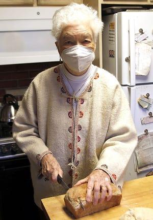 Janet Calhoun slices a loaf of her sourdough bread. TOM E. PUSKAR/TIMES-GAZETTE.COM