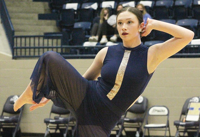 Among Bartlesville High's most dedicated student-athletes are the Poms, including Bella Morrison, shown performing during halftime of a recent home basketball game.