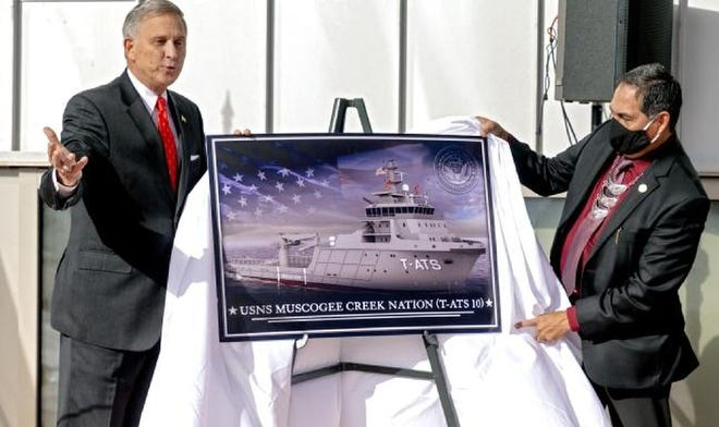 Acting Under Secretary of the Navy, Gregory J. Slavonic, left, and Muscogee (Creek Nation) Chief David Hill unveil the naming of the naval ship USNS Muscogee Creek Nation during a Navy press conference Friday at the First Americans Museum in Oklahoma City.