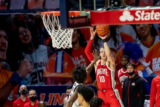Jan 16, 2021; Champaign, Illinois, USA; Ohio State Buckeyes forward Justin Ahrens (10) hits a three point shot during the second half against the Illinois Fighting Illini at the State Farm Center. Mandatory Credit: Patrick Gorski-USA TODAY Sports
