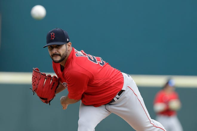Martin Perez warms up during a spring training game against the Pirates last year.