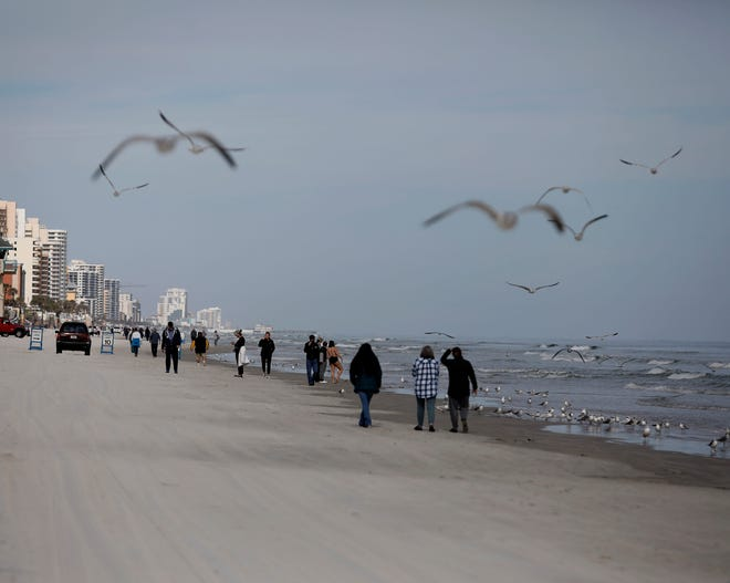 The temperatures on Sunday, Jan. 17, 2021, was a little chilly for some Floridians, but that did not stop them from enjoying a nice stroll on the beach.