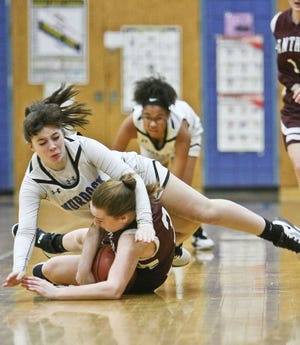 Murdock's Kaliegh Lauziere, seen falling on Ayer-Shirley's Maddie Davis as they both scrambled to collect a loose ball during a game last season, returns for her senior season as the starting point guard for the Blue Devils.