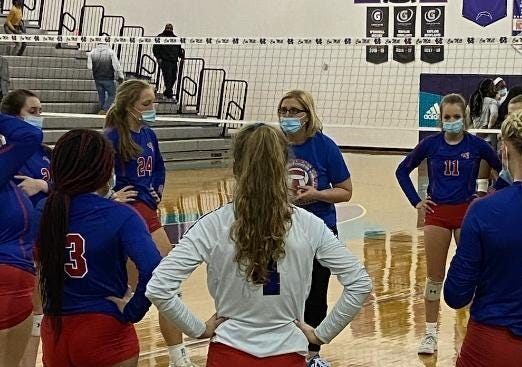 West Henderson coach Tiffany Lowrance talks with her team during a timeout at Saturday's 3-A state quarterfinals at Cox Mill.