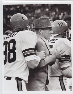 Coach Paul Brown with Cincinnati Bengals players Coslet and McClure.
