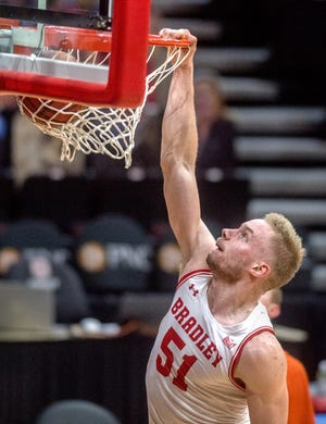 Bradley's Rienk Mast dunks over Evansville in the first half Saturday, Jan. 16, 2021 at Carver Arena in Peoria.