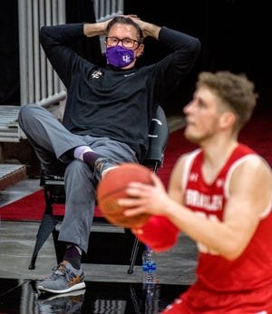 Evansville head coach Todd Lickliter sits back and watches as Bradley's Ville Tahvanainen prepares to launch a three-pointer in the first half Sunday, Jan. 17, 2021 at Carver Arena in Peoria. The Braves defeated the Aces 86-55.