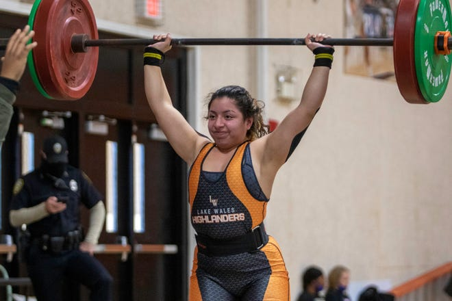Lake Wales senior Faith Garza completes her lift en route to winning the 169-pound division on Saturday at the Polk County Girls Weightlifting Meet at Lake Wales High School.