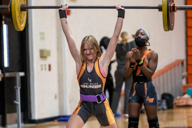 Lake Wales senior Kiara Hobbs completes her lift on the clean and jerk en route to winning the 101-pound division on Saturday at the Polk County Girls Weightlifting Meet at Lake Wales High School.