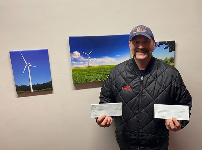 Middletown Fire Protection District Chief Josh Gasparini recently accepted a $2,000 donation from Liberty Power, owner of Sugar Creek Windfarm and Sugar Creek Solar.