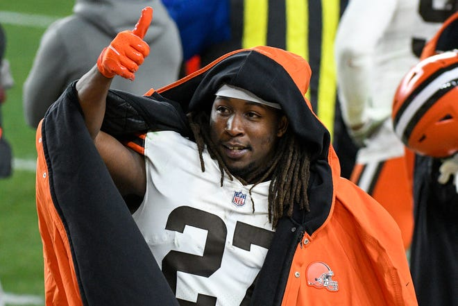 Cleveland Browns running back Kareem Hunt (27) celebrates on the sideline during the first half of an NFL wild-card playoff football game against the Pittsburgh Steelers in Pittsburgh, Sunday, Jan. 10, 2021.