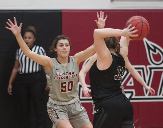 Central Christian College of the Bible freshman Devin Clark from Higbee (#50) defends Manhattan Christian College's Jordan Lewis during the Lady Saints home game Saturday afternoon. Clark scored 14 points to help the Lady Saints edge their Midwest Christian College Conference foe 64-60.