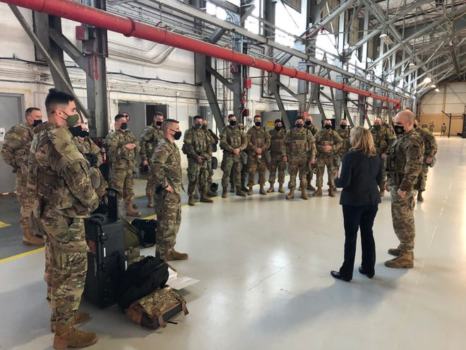 U.S. Sen. Maggie Hassan greets N.H. National Guard troops on Saturday at Joint Base Andrews in Maryland, where they were flown by the 157th Air Refueling Wing out of Pease to help fortify security in Washington, D.C., for Wednesday's inauguration of President-elect Joe Biden.