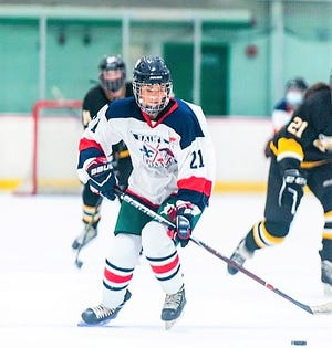 Kylie Youngclaus, a senior on the St. Thomas Aquinas/Winnacunnet/Dover girls hockey team, skates down the ice during Saturday's season opening game against Souhegan at Dover Ice Arena.