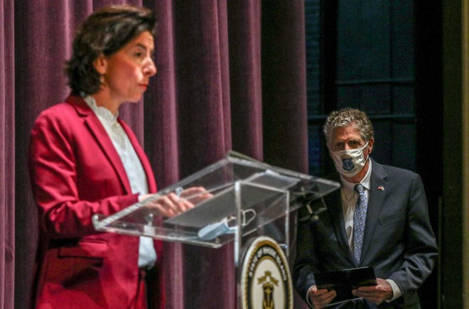 Rhode Island Gov. Gina Raimondo and Lt. Gov. Dan McKee on the stage of Veterans Memorial Auditorium during last week's briefing on the planned transfer of executive power. McKee has been contacted by at least 10 people seeking to be his successor.