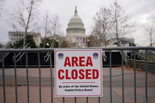 Signs are posted to close the area around the U.S. Capitol ahead of the inauguration of President-elect Joe Biden and Vice President-elect Kamala Harris in Washington.