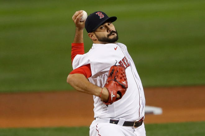 Red Sox starting pitcher Martin Perez delivers during a mid-September game against the New York Yankees at Fenway Park.