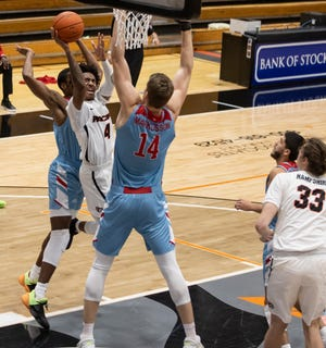 Pacific Tigers guard Daniss Jenkins (4) attempts a shot around Loyola Marymount Lions center Mattias Markusson (14) during the first half during the WCC men's basketball game Jan. 16 Spanos Center in Stockton.