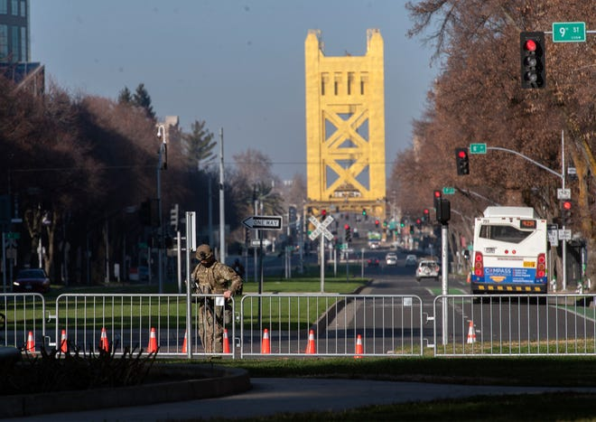 Capitol Mall and 9th Street is barricaded and under heavy security on Sunday in downtown Sacramento. There were no immediate reports of any clashes and feared violence had not occurred by midday Sunday.