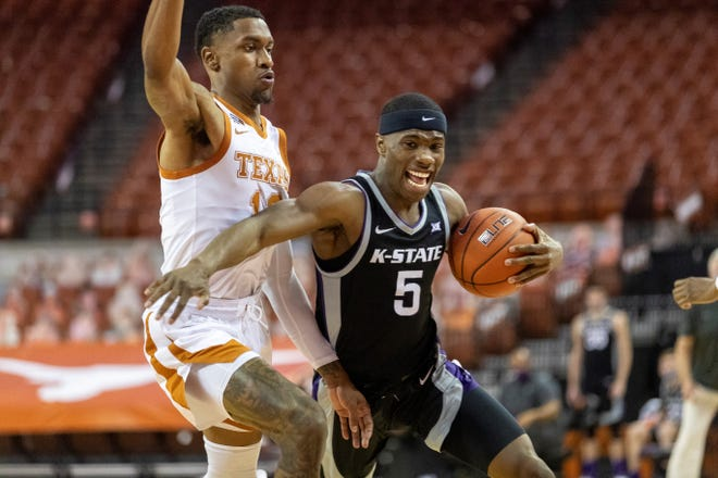 Kansas State guard Rudi Williams goes hard to the basket against Texas' Jase Febres during the first half Saturday night at the Frank Erwin Center in Austin, Texas.