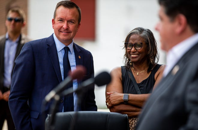Illinois State Sen. Andy Manar, D-Bunker Hill, stands with Doris Turner, Ward 3 Alderman in Springfield, right, as Illinois Gov. J.B. Pritzker answers questions after signing into law a massive expansion of gambling in Illinois and a $45 billion construction and infrastructure plan during a ceremony at the Lincoln Depot, Friday, June 28, 2019, in Springfield, Ill. The capital plan includes $122 million to complete work on relocating train traffic in Springfield away from the Third Street corridor and onto 10th Street. [Justin L. Fowler/The State Journal-Register]