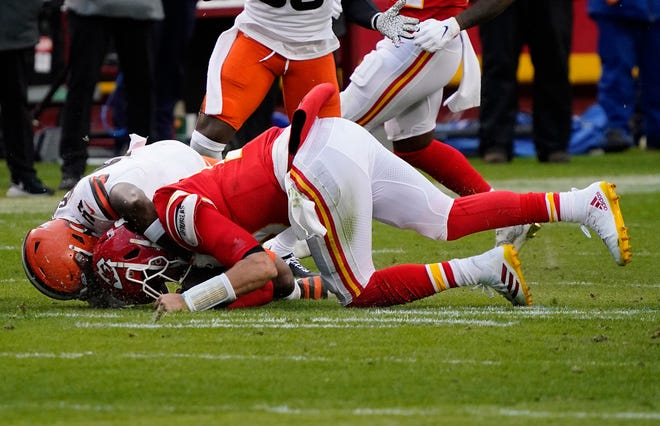Kansas City Chiefs quarterback Patrick Mahomes (15) is brought down by Cleveland Browns outside linebacker Mack Wilson (51) during the second half of Sunday's AFC divisional round playoff game at Arrowhead Stadium in Kansas City, Mo. Mahomes would suffer a concussion on the play and did not return.
