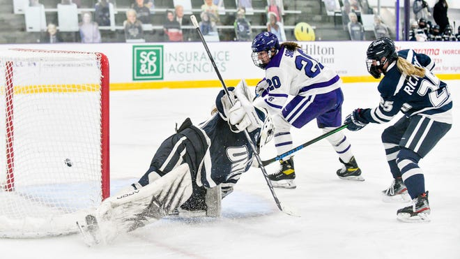Millie Sirum, shown here scoring against New Hampshire earlier this season, got Holy Cross on the board early in Saturday night's third period against Boston College.