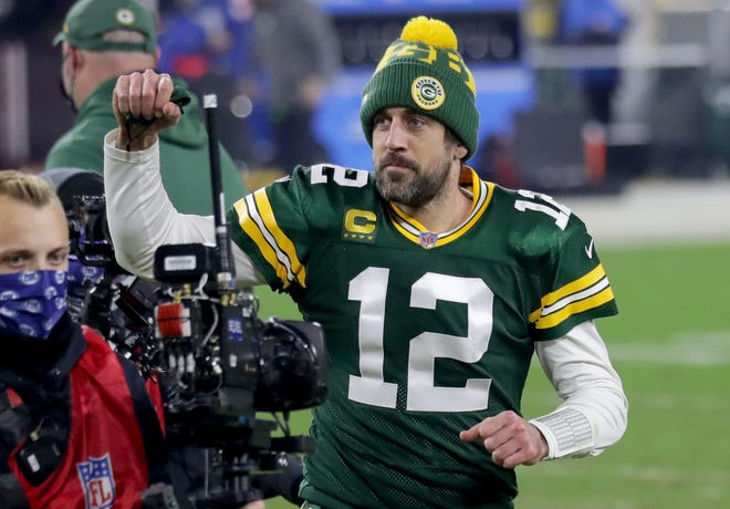 Packers quarterback Aaron Rodgers acknowledges the fans as he runs off the field after the Packers' victory over the Rams.