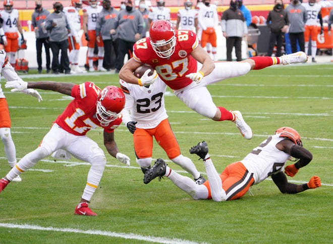 Chiefs tight end Travis Kelce (87) leaps over Browns strong safety Karl Joseph (42) to score a touchdown during the first half Sunday at Arrowhead Stadium.